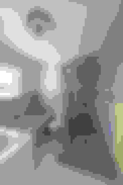 Baños de estilo  por Spegash Interiors