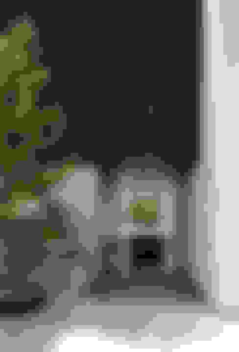 Casas de estilo  por 松岡淳建築設計事務所