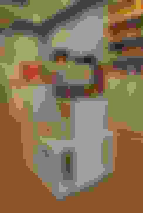 Exhibidores: Espacios comerciales de estilo  por Rodrigo León Palma