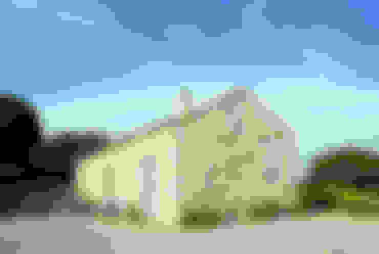 Casas de estilo  por FTA Filippo Taidelli Architetto