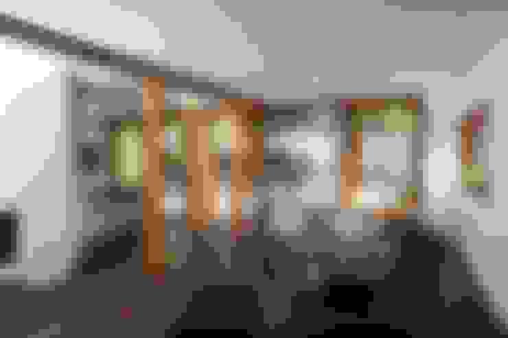 Living room by Holzerarchitekten