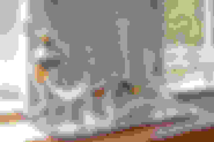 Living room by Eliska Design Associates Ltd.
