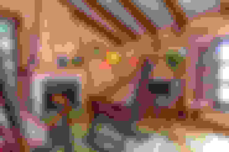 Salas / recibidores de estilo  por Espacios y Luz Fotografía