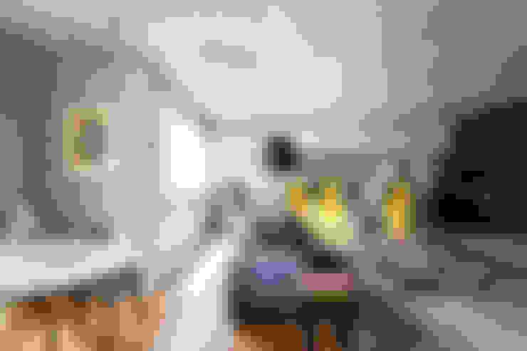 PROJETO PEIXOTO GOMIDE: Salas de estar  por Suite Arquitetos