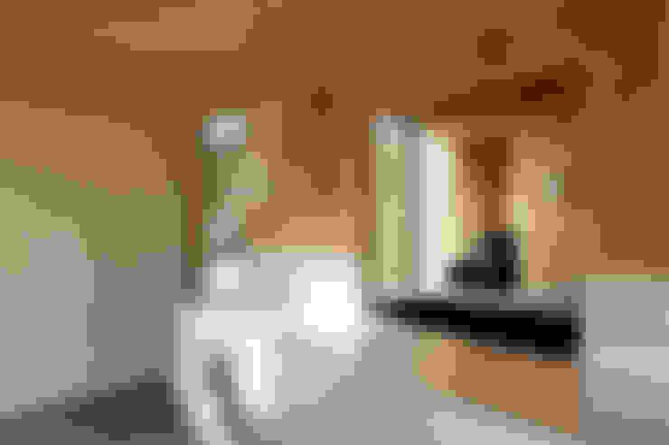 maison G: Maisons de style  par Lode Architecture