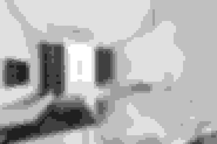 Salas / recibidores de estilo  por Arch. Andrea Pella