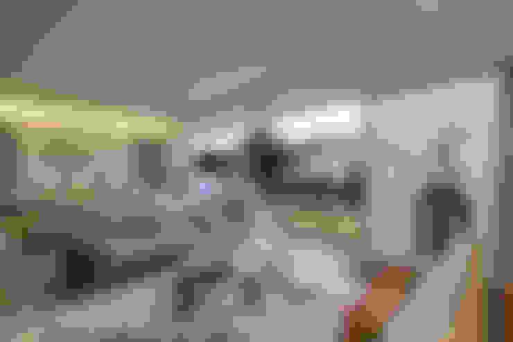 Salas de estilo  por Grupo Arquidecture