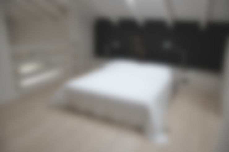 Dormitorios de estilo  por PAOLO CAPRIGLIONE ARCHITETTO