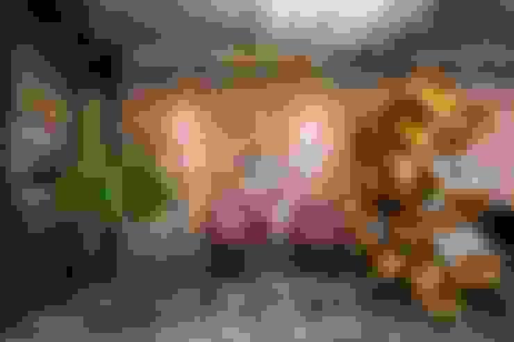 Estante Cruzada: Sala de estar  por Pedro Braga Design