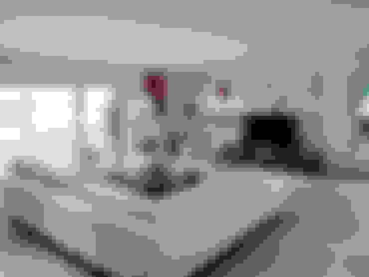 Livings de estilo  por Jean-Paul Magy architecte d'intérieur