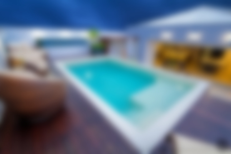DECK / PISCINA:   por injy Interior Design