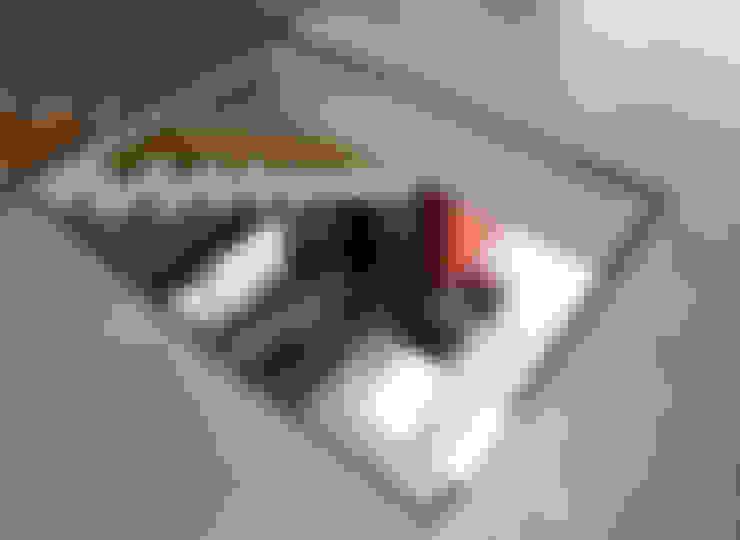Salas / recibidores de estilo  por Studio 06