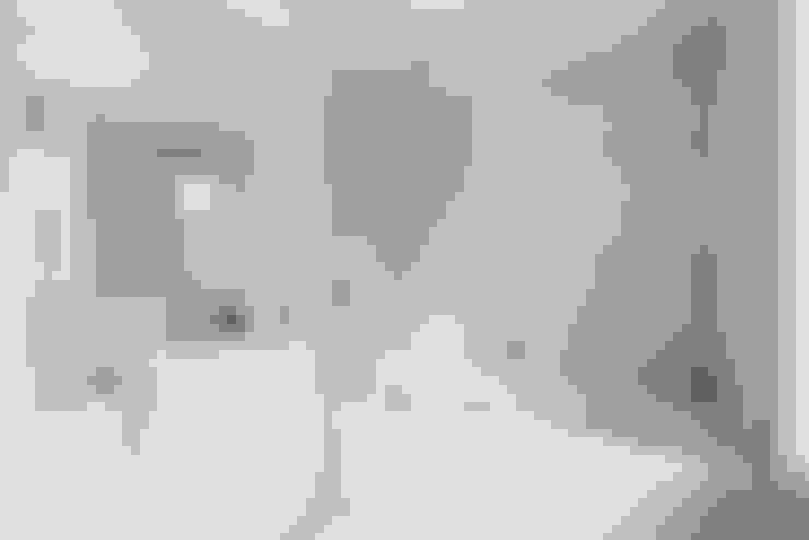 Baños de estilo  por Granit Architects