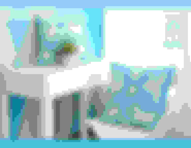 Cojines turquesa con bordado blanco: Hogar de estilo  por molduartemarcos