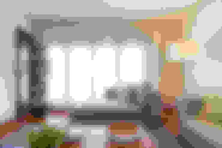 Salas de estar  por Traço Magenta - Design de Interiores