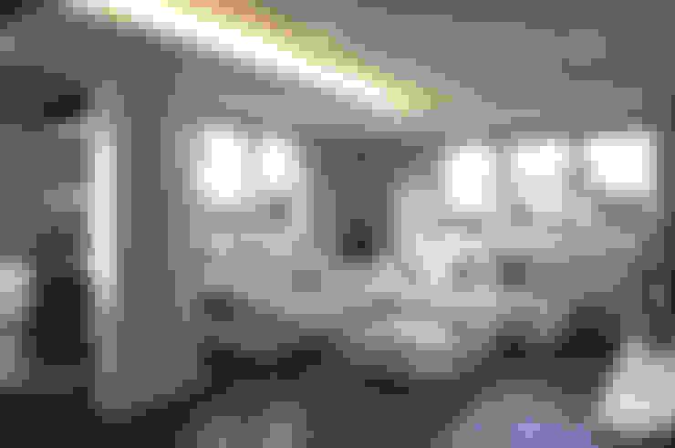 Salas / recibidores de estilo  por Intra Arquitectos