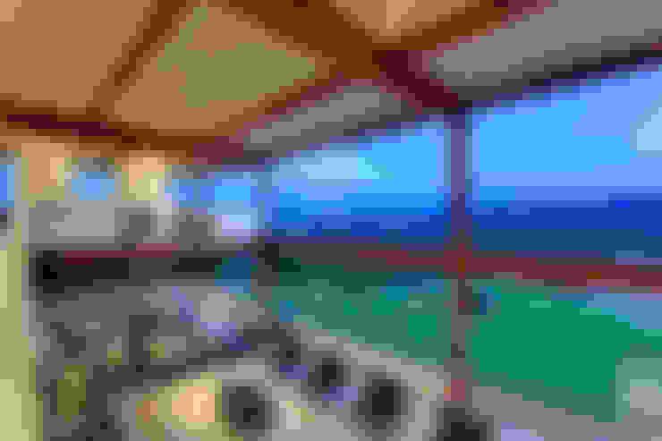 Vista do living montanhas: Salas de estar  por Denise Macedo Arquitetos Associados
