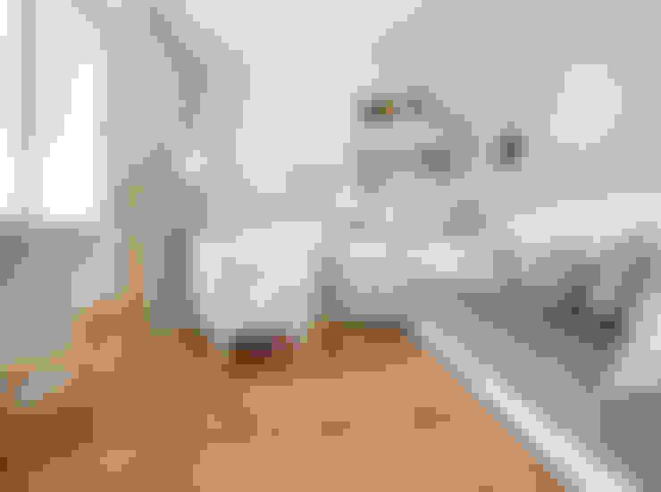 Dormitório bebê: Quarto infantil  por Blacher Arquitetura