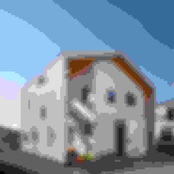 Casas de estilo  por 리을도랑아틀리에