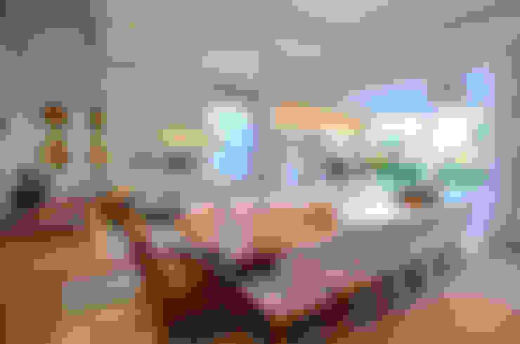 Casa Terra Ville I: Salas de jantar  por Studio Cinque