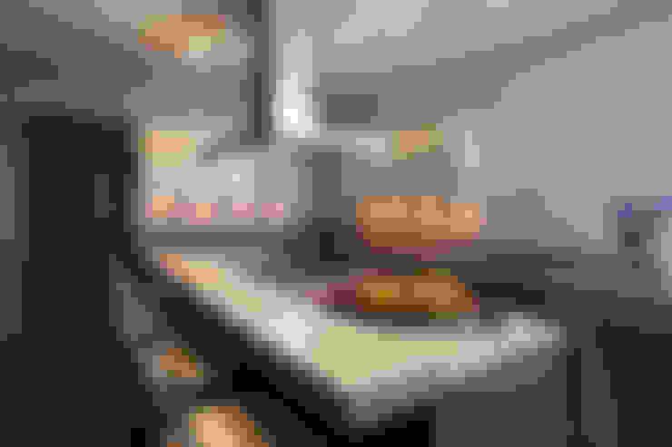 Departamento DL: Cocinas de estilo  por kababie arquitectos