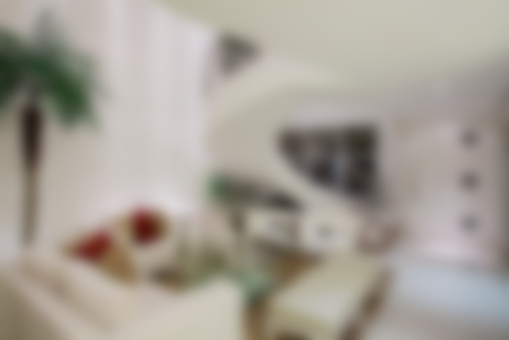 Salas de estar  por Designer de Interiores e Paisagista Iara Kílaris