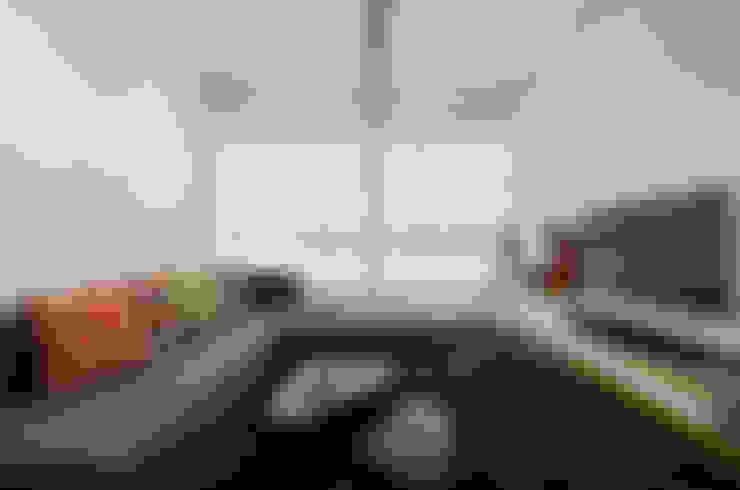 Apartamento Publicitária: Salas de estar  por Johnny Thomsen Arquitetura e Design