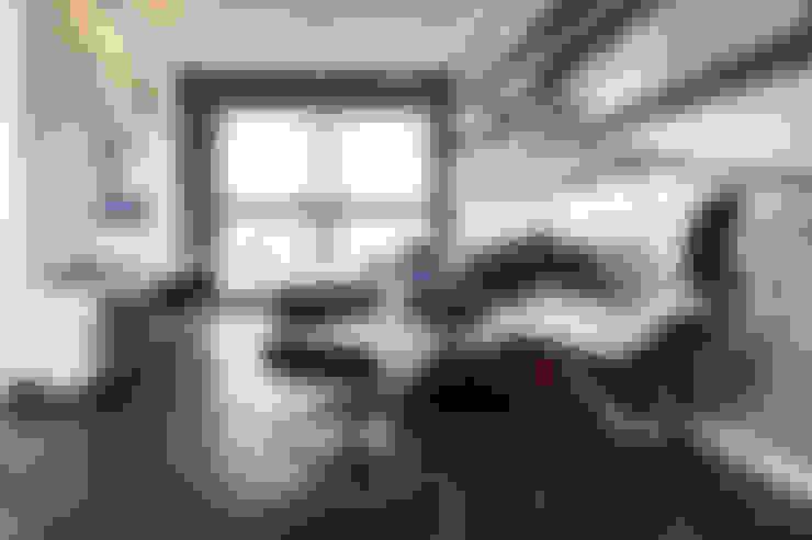 Apartamento JG: Salas de estar  por Moove Arquitetos