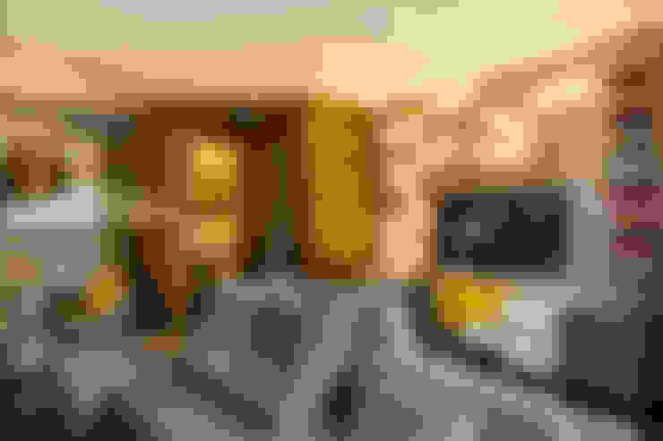 Livings de estilo  por Studiodwg Arquitetura e Interiores Ltda.