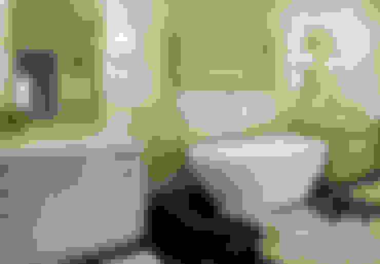Baños de estilo  por Oikos Design