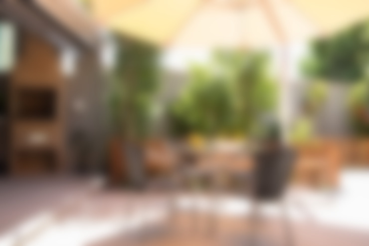 Garden by Marcos Contrera Arquitetura & Interiores