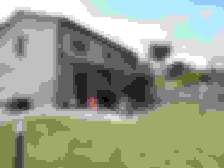 Casas de estilo  de Milligan&Milligan