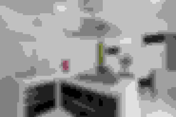 Casa Tamboré: Cozinhas  por Arquiteto Aquiles Nícolas Kílaris
