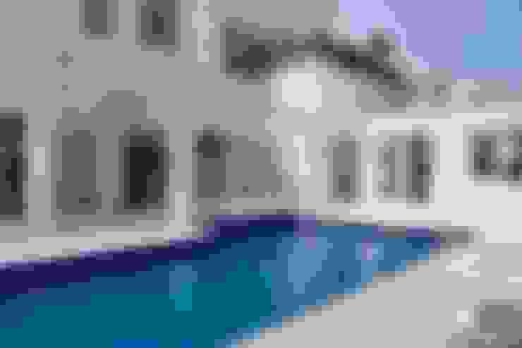 Piscina com Spa integrado (vista externa): Piscinas  por dsgnduo