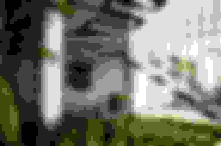 Ingresso & Corridoio in stile  di ARKOT arquitectura + construcción