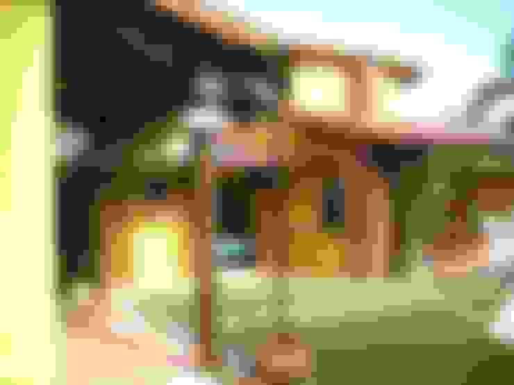 Estruturas em tora de eucalipto tratada: Casas  por Metamorfose Arquitetura e Urbanismo