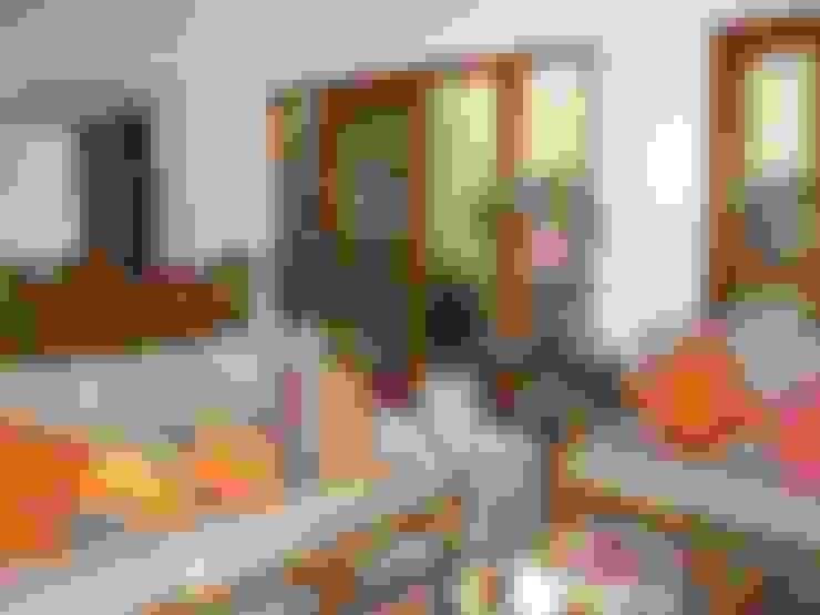 Sala: Salas de estar  por Metamorfose Arquitetura e Urbanismo