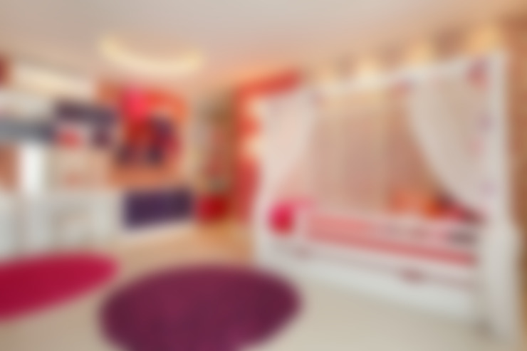 Nursery/kid's room by Arquitetura e Interior