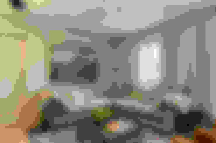 APARTAMENTO GW: Salas de estar  por AMBIDESTRO