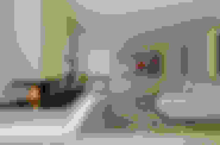 Salas / recibidores de estilo  por luogo comune