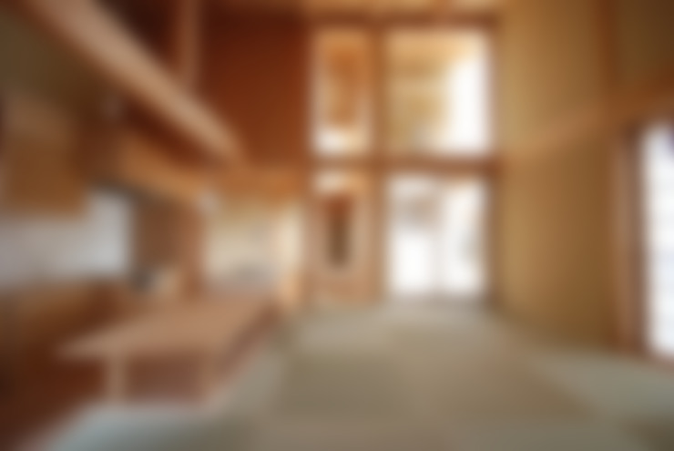 庭つくりの家: 神谷建築スタジオが手掛けたリビングです。