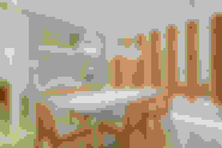 Esszimmer von Rolim de Moura Arquitetura e Interiores