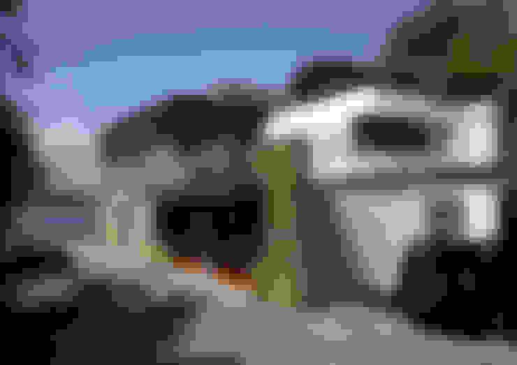 Casas  por Atelier de l'Ile