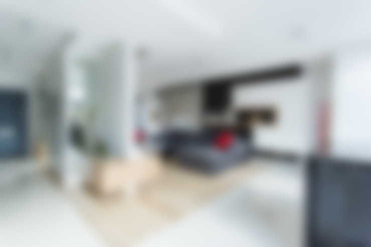 Open plan living room:  Living room by GK Architects Ltd