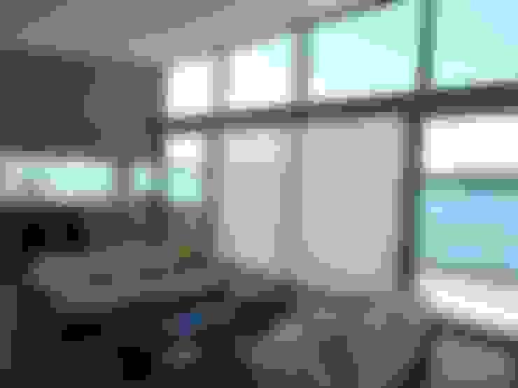 Salas de estar  por Atelier de l'Ile