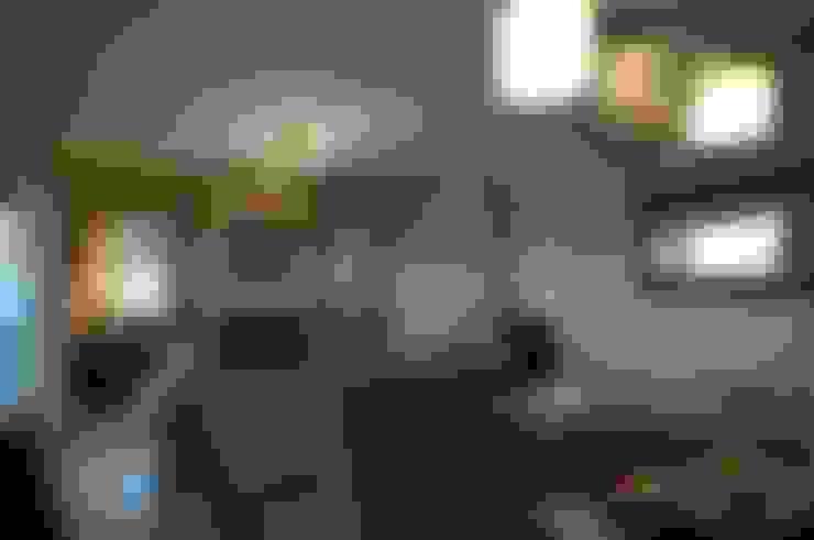 La Casa del Lago: Livings de estilo  por Family Houses