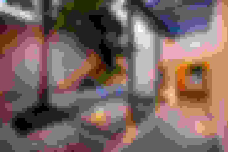 Casa WS52: Jardines de estilo  por Taller Estilo Arquitectura