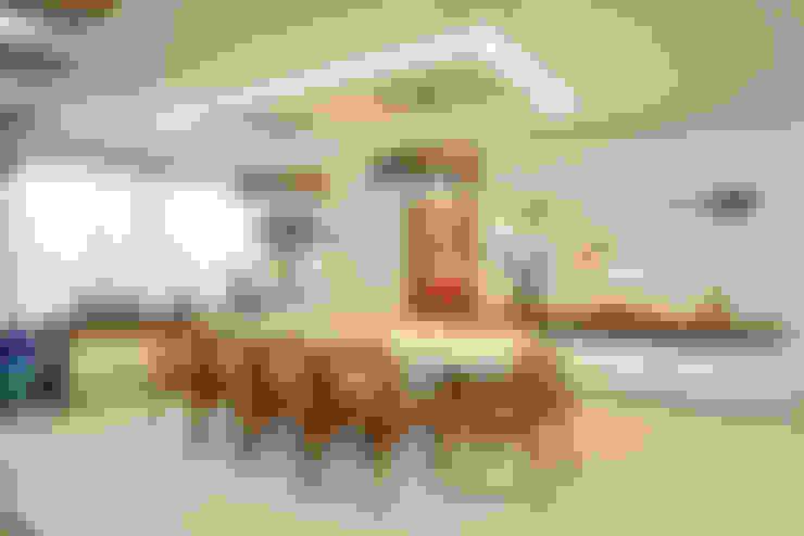 Sala de jantar: Salas de jantar  por Pinheiro Martinez Arquitetura