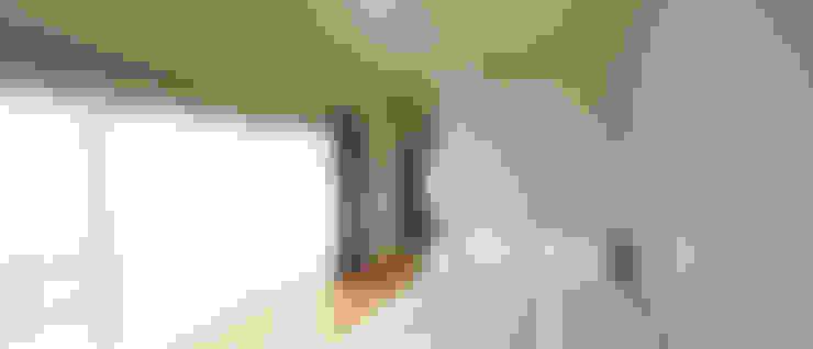 Dormitorios de estilo  de johsungwook architects