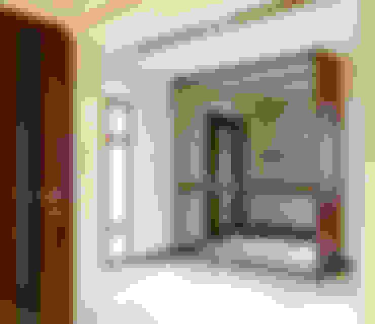 Vestíbulos, pasillos y escaleras de estilo  por ArtDecoprojekt